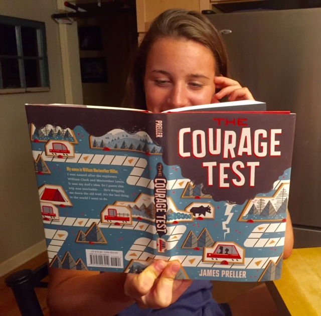 In this photo, I'm showing off the fabulous wrap-around cover for THE COURAGE TEST . . . as well as my daughter Maggie's lovely forehead.